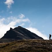 Anna Dóra Hermannsdóttir and Örn Arngrímsson hiking at Klængshóll travel farm, Skíðadalur, North Iceland.