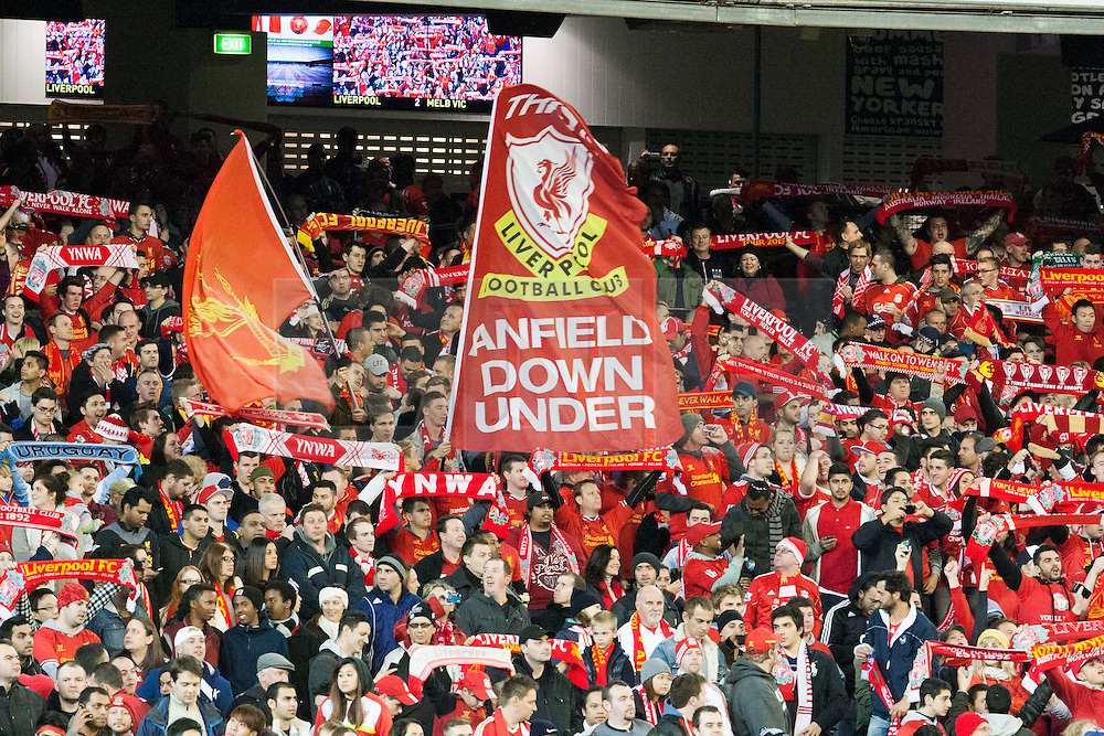 © Licensed to London News Pictures. 24/7/2013. Liverpool fans with a banner that read 'Anfield down under'  during the Melbourne Victory Vs Liverpool F.C at the Melbourne Cricket Ground, Melbourne, Australia. Photo credit : Asanka Brendon Ratnayake/LNP