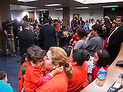 22 FEBRUARY 2011 - PHOENIX, AZ:  Rosio Casteneda (CQ) hugs her daughter Evelyn Casteneda, 3, (CQ) during an immigrants' rights press conference at the State Capitol in Phoenix Tuesday. Hundreds of people including supporters of immigrants' rights, supporters of border defense, motorcycle riders and members of the Tea Party, converged on the capitol to express their views on bills.     PHOTO BY JACK KURTZ