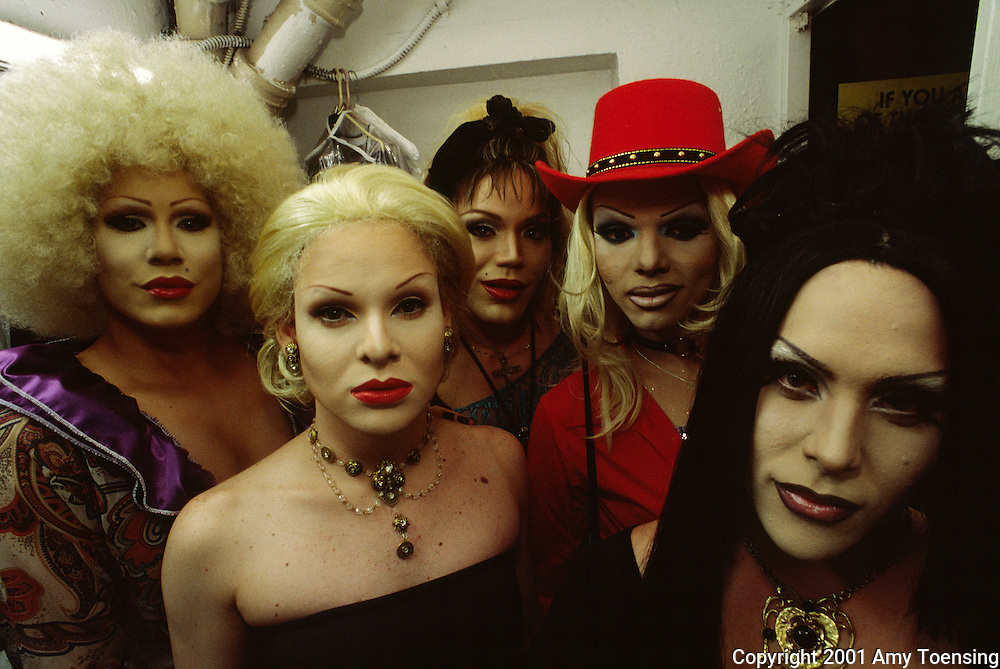 SANTURCE, PR - JULY 25: A group of transvestites get ready for Madonna Madness night at Eros, a gay night club July 25, 2001 in Santurce, Puerto Rico. Puerto Rico was an outpost of Spanish colonialism for 400 years, until the United States took possession in 1898. Today Puerto Rico's Spanish-speaking culture reflects its history - a mix of African slaves, Spanish settlers, and Taino Indians. Puerto Ricans fight in the U.S. armed forces but are not entitled to vote in presidential elections. They passionately debate their relationship with the U.S. with about half the island wanting to become the 51st state and the other half wanting to remain a U.S. commonwealth. A small percentage feel the island should be an independent country. While locals grapple with the evils of a burgeoning drug trade and unchecked development, drumbeats still drive the rhythms of African-inspired bomba music. (Photo By Amy Toensing) _________________________________<br />