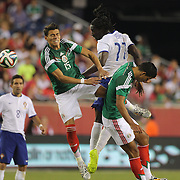Éder, (centre), Portugal, wins a header from Héctor Moreno, (left), Mexico, during the Portugal V Mexico International Friendly match in preparation for the 2014 FIFA World Cup in Brazil. Gillette Stadium, Boston (Foxborough), Massachusetts, USA. 6th June 2014. Photo Tim Clayton