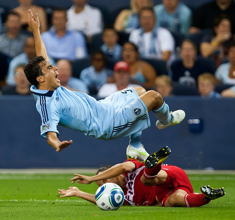 Sporting Kansas City midfielder Omar Bravo was undercut by Chicago Fire's Bratislav Ristic, lower, late in the second half during the MLS game on June 9, 2011, during the inaugural game at Livestrong Sporting Park in Kansas City, Kan. The game ended in a 0-0 tie.