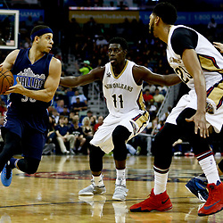 Dec 26, 2016; New Orleans, LA, USA;  Dallas Mavericks guard Seth Curry (30) drives in as New Orleans Pelicans guard Jrue Holiday (11) and forward Anthony Davis (23) defend during the first quarter of a game at the Smoothie King Center. Mandatory Credit: Derick E. Hingle-USA TODAY Sports