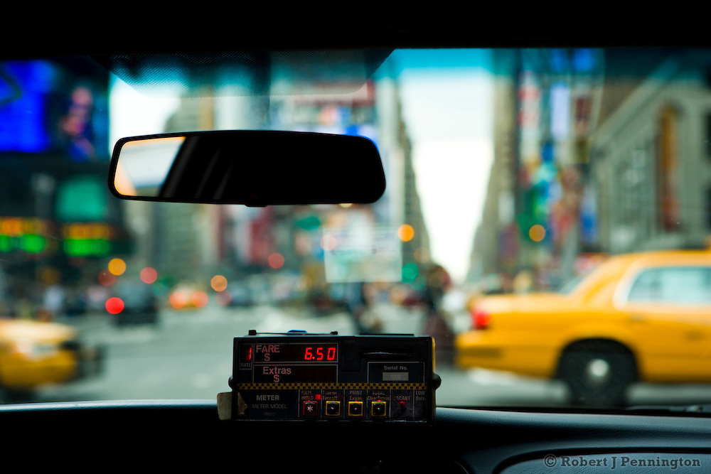 Interior of New York City taxicab with meter running, looking through the windshield towards Times Square in New York City, NY, USA