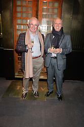 Left to right, JOHN REID and ? at a private view of Made in Britain featuring contents from The Ivy sold to benefit Child Bereavement UK held at Sotheby's, 34-35 New Bond Street, London on 23rd March 2015.