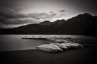 While camping in Jasper my Dad and I got up to see the sunrise at Pyramid Lake. It was raining and the sunrise never really developed, but we found some beautiful locations with Pyramid Mountain reflecting on Pyramid Lake.  The canoes on the shore of the lake also added to the scenic landscape!..©2010, Sean Phillips.http://www.RiverwoodPhotography.com