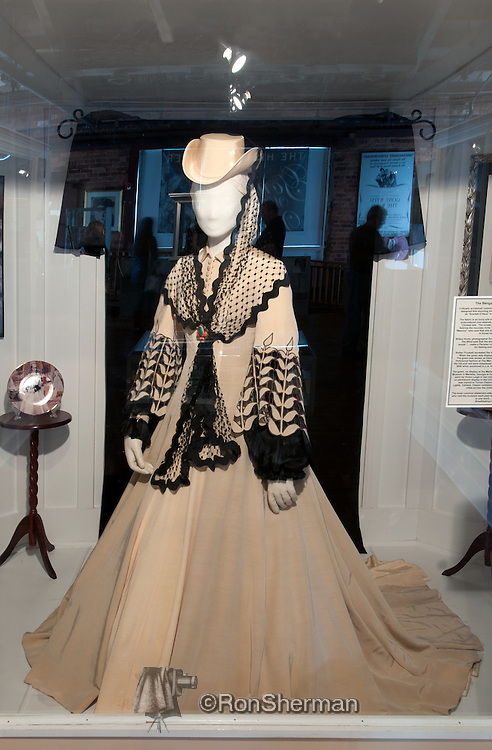 """The Bengaline Gown.  Critically acclaimed costume designer Walter Plunkett designed this dress worn by Vivian Leigh as """"Scarlett O'Hara"""".  The Marietta Gone with the Wind Museum: Scarlett on the Square has an extensive collection of Gone with the Wind movie memorabilia and features the sights and sounds of Atlanta during the Civil War and Reconstruction, narrated by Scarlett O'Hara and Rhett Butler. The museum is located just one block off Marietta Square in the circa 1880 Old Thomas Warehouse building."""