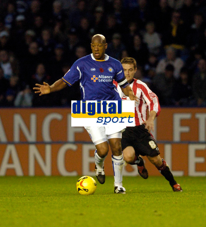 Photo: Leigh Quinnell.<br /> Leicester City v Southampton. Coca Cola Championship.<br /> 05/11/2005. Leicesters Dion Dublin makes his move past Southamptons Matthew Oakley.
