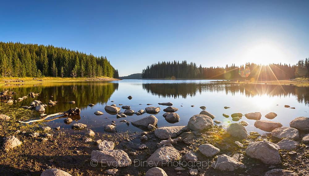 Sunshine morning by a beautiful mountain lake