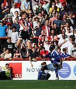 Harlee Dean toweing over Josh Emmanuel during the Sky Bet Championship match between Brentford and Ipswich Town at Griffin Park, London, England on 8 August 2015. Photo by Matthew Redman.