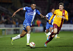 Peterborough United's Britt Assombalonga in action with Bradford City's Adam Reach  - Photo mandatory by-line: Joe Dent/JMP - Mobile: 07966 386802 18/04/2014 - SPORT - FOOTBALL - Bradford - Valley Parade - Bradford City v Peterborough United - Sky Bet League One