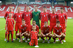 Wrexham, Wales - Wednesday, August 12th, 2009: Wales' players line-up for a team group photograph before the UEFA Under 21 Championship Qualifying Group 3 match at the Racecourse Ground. L-R: Shaun MacDonald, Marc Williams, Joe Partington, goalkeeper Chris Maxwell, Mark Bradley, Darcy Blake, Ched Evans. Front row L-R: mascot, Christian Ribeiro, Neil Taylor, macott, Andy King, Arron Morris. (Photo by Chris Brunskill/Propaganda)