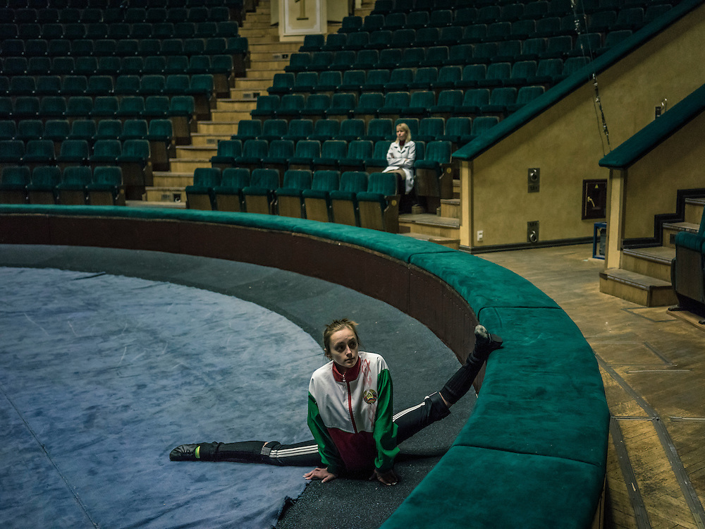 A circus acrobat stretches before a practice session on Wednesday, November 25, 2015 in Minsk, Belarus.