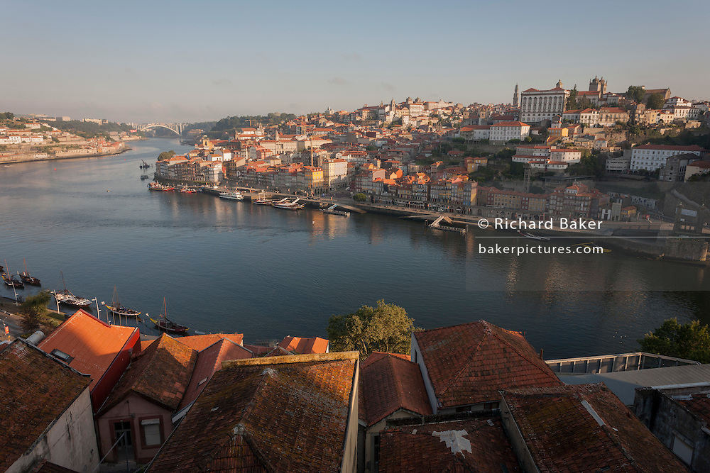 A morning aerial panorama of the city of Porto on the River Douro and a foreground of housing rooftops, on 20th July, in Porto, Portugal. (Photo by Richard Baker / In Pictures via Getty Images)