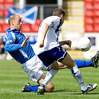 St Johnstone v Morton....02.05.09<br /> Paul Sheerin tackles Kevin Finlayson<br /> Picture by Graeme Hart.<br /> Copyright Perthshire Picture Agency<br /> Tel: 01738 623350  Mobile: 07990 594431