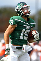 01 October 2016:  Adam Muellers smiles all the way to the endzone after catching a pass and avoiding J.Moore during an NCAA division 3 football game between the Wheaton Thunder and the Illinois Wesleyan Titans in Tucci Stadium on Wilder Field, Bloomington IL (Photo by Alan Look)