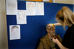 © Licensed to London News Pictures. 26/04/2016. Redcar, UK. A volunteer has make-up applied ahead of filming for the build up to the 2018 Festival of Thrift. 80 volunteers are helping artist and film-maker Richard DeDomenici make a 'Redux' version of the five minute Dunkirk scene from the 2007 Oscar winning film Atonement on Redcar beach. The Festival of Thrift, 19th – 25th August 2018, is a week-long programme of temporary art installations in locations across the Tees Valley landscape. Photo credit: Nigel Roddis/LNP