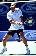 Sport,Tennis,Thomas Enqvist (SWE) spielt Rueckhand Return, beidhaendig,Kappe,schwedische Flagge, Grand Slam Turnier, Australian Open 2000, Ball im Schlaeger, Grimasse,<br /> aufgeblasene Backen,<br /> Aktion,Einzelbild,Ganzkoerper,<br /> Hochformat,