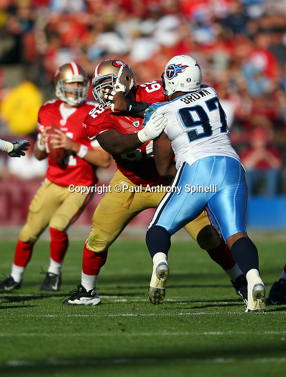 San Francisco 49ers guard Chico Rachal (62) blocks Tennessee Titans defensive tackle Tony Brown (97) during the NFL football game against the Tennessee Titans, November 8, 2009 in San Francisco, California. The Titans won the game 34-27. (©Paul Anthony Spinelli)