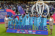 Moeen Ali of England and Adil Rashid of England who are devout Muslims uphold their religious beliefs during the trophy celebrations and make a quick exit to the left before the champaigne is opened and sprayed during the ICC Cricket World Cup 2019 Final match between New Zealand and England at Lord's Cricket Ground, St John's Wood, United Kingdom on 14 July 2019.