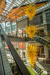 USA, Washington, Bellevue. Dale Chihuly glass art hangs in the shopping atrium of the Elements apartment building in downttown Bellevue.