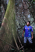 Teddy Yurarina, jungle guide and secretary of ecology and environment for the local Cocoma tribe stands by a Lapuna tree with a base of 32 feet (10.5 metres) in the Pacaya Samaria national reserve.<br /> The mighty Lapuna tree is known amongst Amazonian tribes as the grandfather of the forest. Being one of the tallest trees in the Amazon a number of myths and folk tales are associated with this charasmatic tree. Due to climate change and illegal logging the future of this magnificant tree is becoming increasingly uncertain.