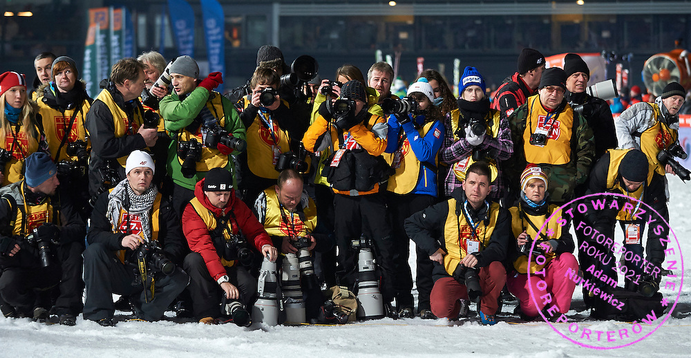 Photographers during FIS World Cup Ski Jumping competition in Zakopane, Poland on January 17, 2015.<br /> <br /> Poland, Zakopane, January 17, 2015.<br /> <br /> Picture also available in RAW (NEF) or TIFF format on special request.<br /> <br /> For editorial use only. Any commercial or promotional use requires permission.<br /> <br /> Mandatory credit:<br /> Photo by &copy; Adam Nurkiewicz / Mediasport