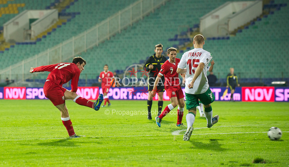 SOFIA, BULGARIA - Tuesday, October 11, 2011: Wales' Gareth Bale scores the only goal of the game against Bulgaria during the UEFA Euro 2012 Qualifying Group G match at the Vasil Levski National Stadium. (Pic by David Rawcliffe/Propaganda)