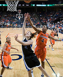 Duke Blue Devils Guard Abby Waner (4) shoots as Virginia Cavaliers Center Siedah Williams (4) tries to defend.  The University of Virginia Cavaliers lost to the #1 ranked Duke University Blue Devils 76-61 at the John Paul Jones Arena in Charlottesville, VA on February 2, 2007.