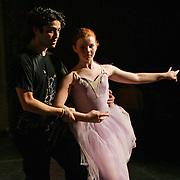 SERKAN - DES MOINES, DEC. 8 -- HANDS ON DIRECTOR - Serkan Usta, artistic director of Ballet Des Moines, walks one of his dancers through a scene of the Nutcracker during a dress rehearsal Monday evening.