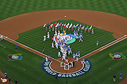 LOS ANGELES, CA - MARCH 21: General view from overhead as flag bearers carry the flags of the 16 competing teams while the Korea team (blue uniforms) shake hands and exchange gifts with Venezuela (white uniforms) during game one of the semifinal round of the 2009 World Baseball Classic at Dodger Stadium in Los Angeles, California on Saturday March 21, 2009. Korea defeated Venezuela 10-2. (Photo by Paul Spinelli/WBCI/MLB Photos)