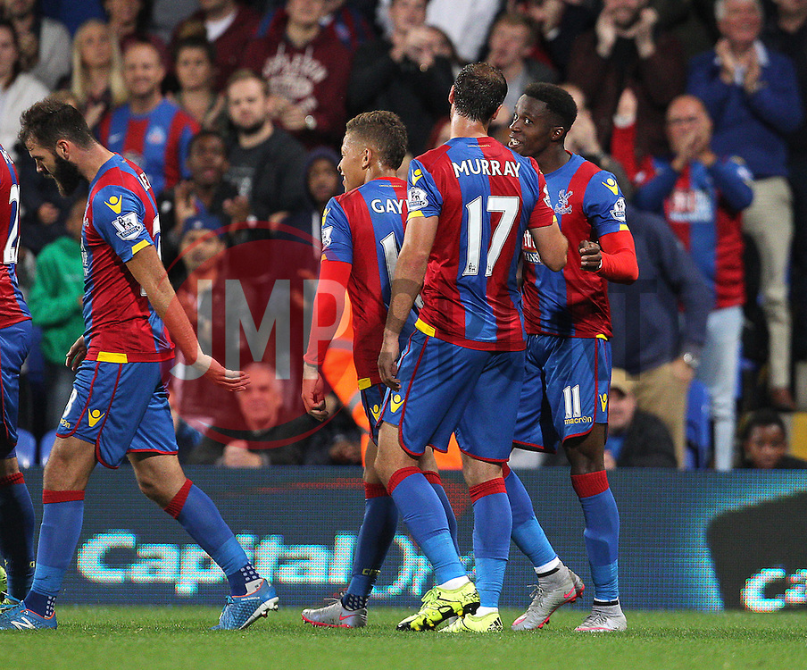 Wilfried Zaha ( R ) of Crystal Palace celebrates with Glenn Murray of Crystal Palace (  2nd R ) after he scores to make it 4-1 - Mandatory byline: Paul Terry/JMP - 07966386802 - 25/08/2015 - FOOTBALL - Selhurst Park -London,England - Crystal Palace v Shrewsbury town - Capital One Cup - Second Round