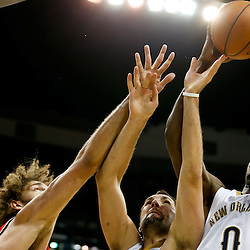 Dec 30, 2013; New Orleans, LA, USA; New Orleans Pelicans small forward Al-Farouq Aminu (0) and New Orleans Pelicans power forward Ryan Anderson (33) battles for a rebound with Portland Trail Blazers center Robin Lopez (42) during the second half of a game at the New Orleans Arena. The Pelicans defeated the Trail Blazers 110-108. Mandatory Credit: Derick E. Hingle-USA TODAY Sports