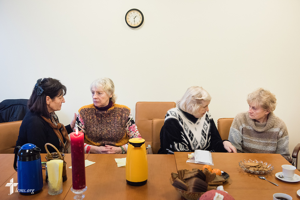 Women engage in fellowship following Divine Service on Wednesday, Feb. 4, 2015, at a Diaconia Center mercy project site based at a municipal apartment in Riga, Latvia. LCMS Communications/Erik M. Lunsford