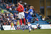 Coventry City forward Marcus Tudgay and Gillingham midfielder Josh Wright battle for the ball during the Sky Bet League 1 match between Gillingham and Coventry City at the MEMS Priestfield Stadium, Gillingham, England on 2 April 2016. Photo by Martin Cole.