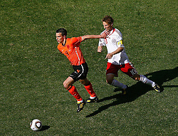 14-06-2010 VOETBAL: FIFA WORLDCUP 2010 NEDERLAND - DENEMARKEN: JOHANNESBURG<br /> Robin Van Persie in action with Martin Jorgensen of Denmark<br /> ©2010-FRH- NPH/  Mark Atkins (Netherlands only)