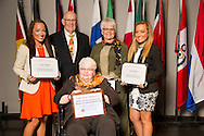 Granger natives Hope (left) and Faith Onstot (right), receive an Oklahoma State University Mable and Houston Ward Sr. Memorial Endowed Scholarship from Houston Ward, Dixie Ward Greer, and Dr. Jewell Ward at the university's recent College of Agricultural Sciences and Natural Resources Scholarships and Awards Banquet. The scholarship is part of more than $1.4 million in scholarships and awards presented to CASNR students for the 2016-2017 academic year. (Photo by Todd Johnson)