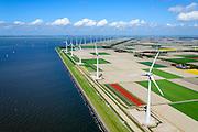 Nederland, Flevoland, Noordoostpolder,  07-05-2015. Westermeerdijk, ten noorden van Urk. Bouw van het grootste windmolenpark van Nederland, Windpark Noordoostpolder. De mega windmolens worden zowel op land als in het IJsselmeer gebouwd, in het water de fundamenten voor de 'off shore' mega windturbines. Het windmolenpark van de Koepel Windenergie Noordoostpolder is een initiatief van NOP Agrowind, energiebedrijf RWE/Essent en Westermeerwind.<br /> Construction of the largest wind farm in the Netherlands, Wind farm Northeast Polder.<br /> luchtfoto (toeslag op standard tarieven);<br /> aerial photo (additional fee required);<br /> copyright foto/photo Siebe Swart