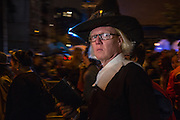 New York, NY, October 31, 2013. A man with a stern expression wearing a Puritan  collar and hat in New York's Greenwich Village Halloween Parade.