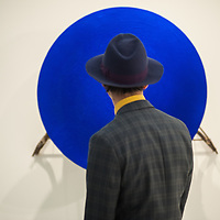 London, UK - 15 October 2014: a man looks at 'La Vitesse Totale' 1958 during the first day of Frieze Art Fair and Frieze Masters in Regent's Park.