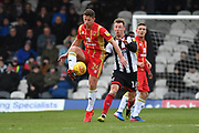 MK Dons player David Wheeler (21) and Grimsby Town midfielder Martyn Woolford(16) during the EFL Sky Bet League 2 match between Grimsby Town FC and Milton Keynes Dons at Blundell Park, Grimsby, United Kingdom on 26 January 2019.