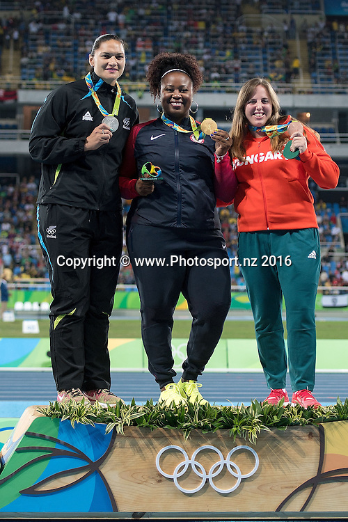 New Zealand's Valerie Adams (L) Silver, Michelle Carter of the USA Gold (C and Anita Marton of Hungry Bronze during a medal ceremony for the Women's Shot Put in Olympic Stadium at the 2016 Rio Olympics on Saturday the 13th of August 2016. © Copyright Photo by Marty Melville / www.Photosport.nz