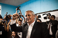 """Presidential candidate Otto Perez Molina arrives at a polling place to make his vote on the day of the Presidential elections, in Guatemala City, Guatemala, on Saturday, Nov. 5, 2011. Molina, a retired military general, won the elections. Fifteen years after the end of its bloody and genocidal civil war, Guatemala elected its first peacetime military leader, a former army general who emerged from military retirement shrouded with human rights abuses. The country that once turned its back on the military, has returned to military power...President Otto Pérez Molina rallied a """"mano dura"""" campaign to fight incessant violence caused by the global drug market, organized crime, and the international financial crisis."""