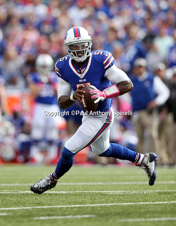 Buffalo Bills quarterback Tyrod Taylor (5) scrambles as he looks to pass in the fourth quarter during the 2015 NFL week 4 regular season football game against the New York Giants on Sunday, Oct. 4, 2015 in Orchard Park, N.Y. The Giants won the game 24-10. (©Paul Anthony Spinelli)