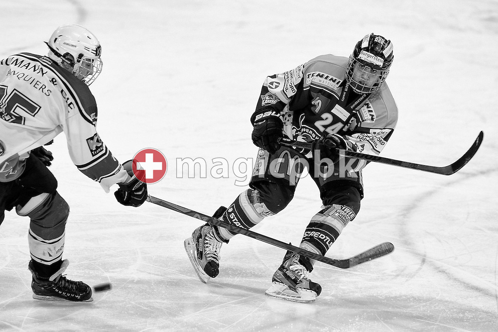 Rapperswil-Jona Lakers defender Lars Mathis (R) against EHC Basel Young Sharks forward Marcell Revesz during a Novizen Elite Relegation ice hockey game between between Rapperswil-Jona Lakers and EHC Basel Young Sharks held at the Diners Club Arena in Rapperswil, Switzerland, Wednesday, March 4, 2015. (Photo by Patrick B. Kraemer / MAGICPBK)