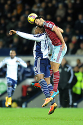West Ham's James Tomkins wins a header against West Bromwich Albion's Victor Anichebe - Photo mandatory by-line: Dougie Allward/JMP - Mobile: 07966 386802 - 02/12/2014 - SPORT - Football - West Bromwich - The Hawthorns - West Bromwich Albion v West Ham United - Barclays Premier League