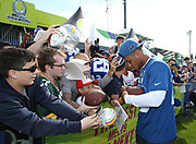 Jan 23, 2019; Kissimmee, FL, USA; New York Giants running back Saquon Barkley (26) signs autographs for fans after NFC practice for the 2019 Pro Bowl at ESPN Wide World of Sports Complex. (Steve Jacobson/Image of Sport)
