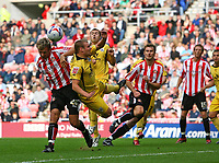 Photo: Andrew Unwin.<br />Sunderland v Barnsley. Coca Cola Championship. 21/10/2006.<br />Sunderland's Chris Brown (L) battles for the ball.