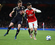 Arsenal striker Oliver Giroud battling for the ball ,during the Champions League match between Arsenal and Dinamo Zagreb at the Emirates Stadium, London, England on 24 November 2015. Photo by Matthew Redman.