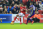 Bristol City midfielder Elliot Bennett and Charlton Athletic defender Tareiq Holmes-Dennis during the Sky Bet Championship match between Bristol City and Charlton Athletic at Ashton Gate, Bristol, England on 26 December 2015. Photo by Jemma Phillips.